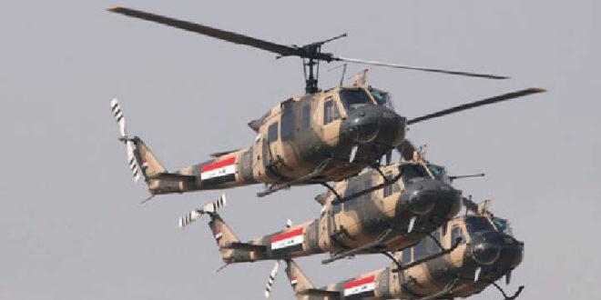 القوات العراقية تلقي منشورات على سكان المدينة القديمة بالموصل