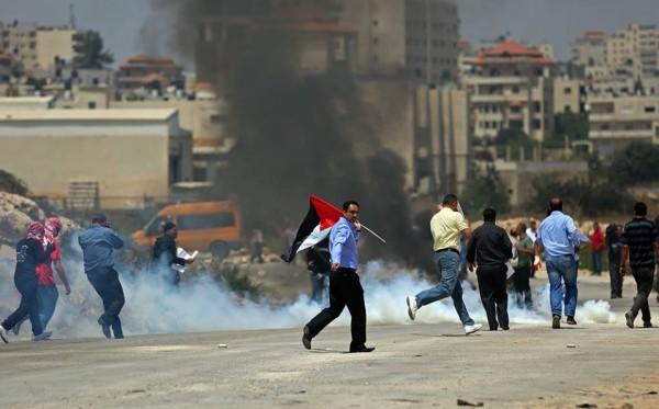 عشرات الاصابات في مسيرة تضامنية مع الأسرى قرب رام الله