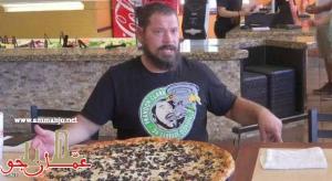 تحد مثير ..  التهم هذه البيتزا تحصل فورا على 500 دولار